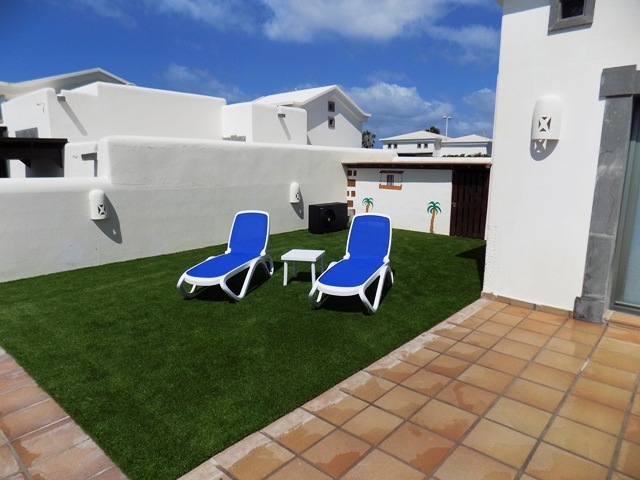 Astroturf area to the side of the villa)