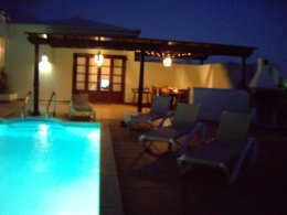 Another view of the Villa, Terrace & Pool at night