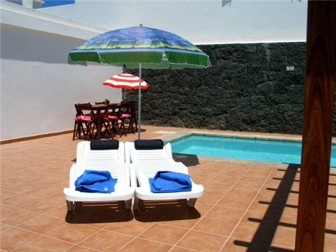 Patio Furniture ; Parasols and 6 Loungers
