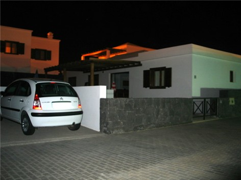 Private parking to side of villa