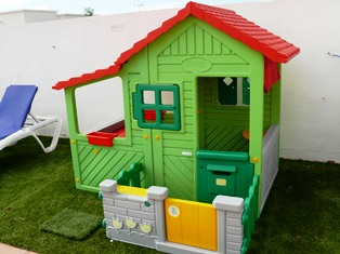 Childrens Playhouse on child-friendly Astroturf