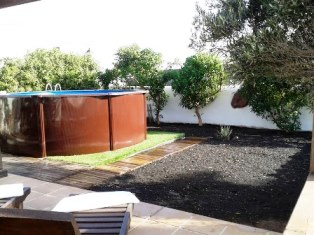 View from Terrace to Pool across Garden