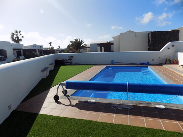 Pool set in Tiled and Astroturfed area