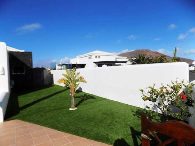 Astroturfed Garden area to side of Villa