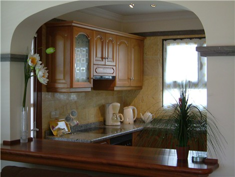view to Kitchen across Breakfast Bar