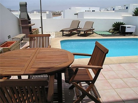 BBQ & Terrace Furniture beside pool