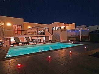 view of Terrace / Private Pool at Night