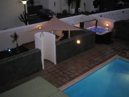 View of shower area / hot tub at night