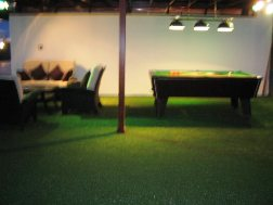 View of the relaxation area / pool table at night