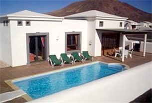 View of Casa Maria across private pool showing Montana Roja in the background