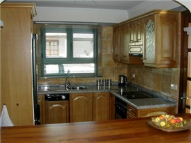 Fully Fitted Kitchen taken from Lounge Breakfast Bar