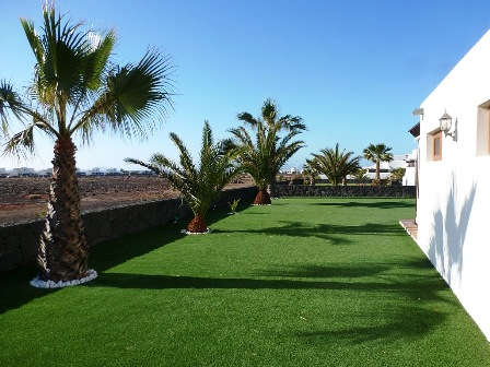 Astroturf to side of Villa Mary
