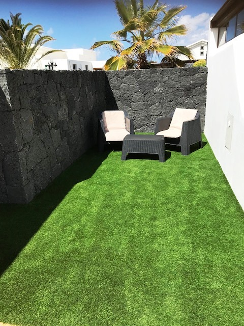 Astroturf to side of Villa