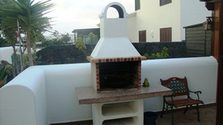 Close up of Canarian BBQ outside dining room