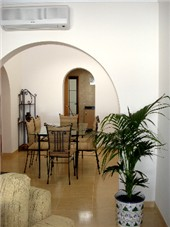 View from Lounge through double archway to Kitchen
