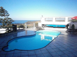 View across private heated pool towards the sea