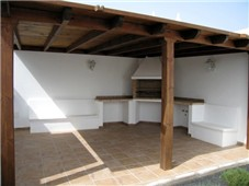 Outdoor, covered Dining Area with BBQ