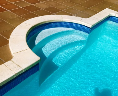 Roman steps to pool enable easy access