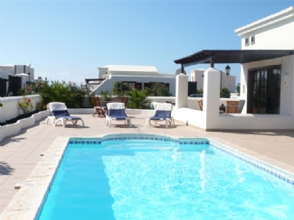 View across Terrace and Private 8m x 4m Heated Pool
